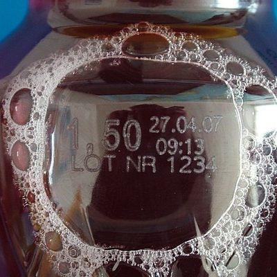Фото лазерной маркировки на PET бутылке
