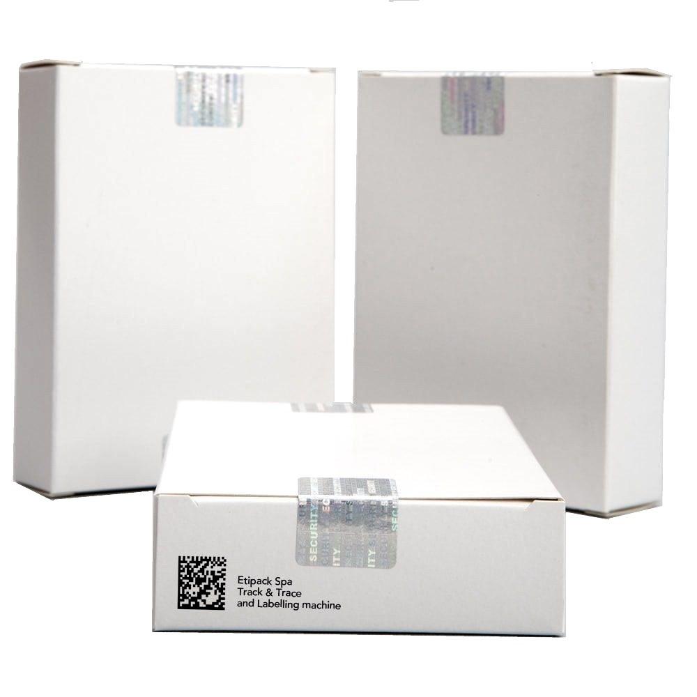 Промаркована картонна упаковка лікарських засобів з етикеткою контролю відкриття